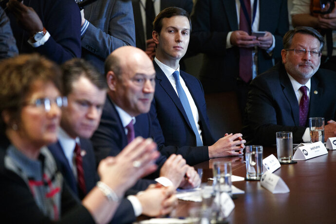 White House senior adviser Jared Kushner listens during a meeting between President Donald Trump and lawmakers about trade policy in the Cabinet Room of the White House, Tuesday, Feb. 13, 2018, in Washington. (AP Photo/Evan Vucci)