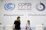 Climate activists Greta Thunberg, right, and Luisa Neubauer arrive for a news conference at the COP25 Climate summit in Madrid, Spain, Monday, Dec. 9, 2019. Thunberg is in Madrid where a global U.N.-sponsored climate change conference is taking place. (AP Photo/Andrea Comas)