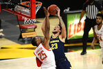 Michigan forward Brandon Johns Jr. (23) goes to the basket next to Maryland forward Jairus Hamilton (25) during the first half of an NCAA college basketball game Thursday, Dec. 31, 2020, in College Park, Md. (AP Photo/Nick Wass)