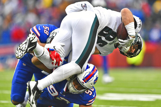 Philadelphia Eagles' Zach Ertz, right, is tackled by Buffalo Bills defenders during the first half of an NFL football game, Sunday, Oct. 27, 2019, in Orchard Park, N.Y. (AP Photo/Adrian Kraus)