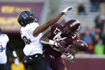 Minnesota wide receiver Rashod Bateman misses a catch against the defense of Northwestern's Cameron Ruiz during an NCAA college football game Saturday, Nov. 17, 2018, in Minneapolis. Northwestern won 24-14. (AP Photo/Stacy Bengs)