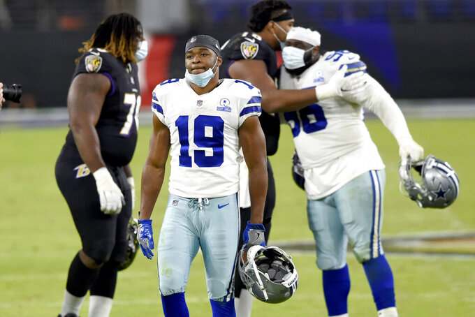 Dallas Cowboys wide receiver Amari Cooper (19) leaves the field after an NFL football game against the Baltimore Ravens, Tuesday, Dec. 8, 2020, in Baltimore. The Ravens won 34-17. (AP Photo/Gail Burton)