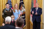 President Donald Trump applauds after awarding the Medal of Honor to Army Sgt. Maj. Thomas P. Payne as he stands with his wife Alison  in the East Room of the White House, Friday, Sept. 11, 2020, in Washington. (AP Photo/Andrew Harnik)