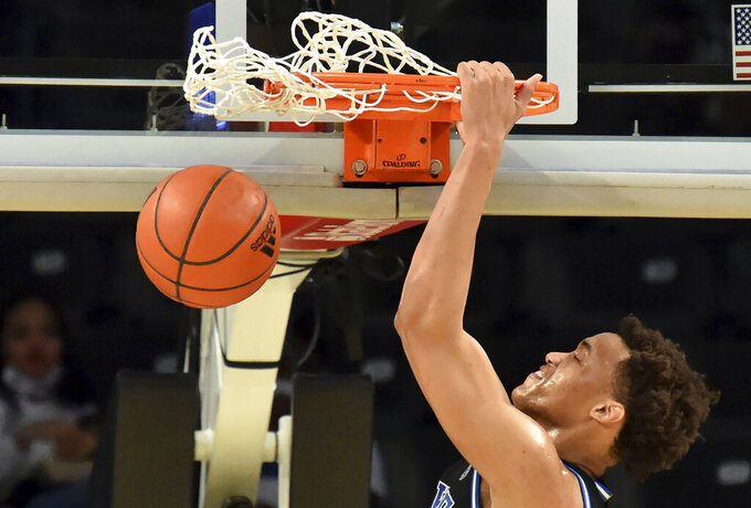 Duke forward Wendell Moore Jr. dunks against Georgia Tech during an NCAA college basketball game Tuesday, March 2, 2021, in Atlanta. (Hyosub Shin/Atlanta Journal-Constitution via AP)