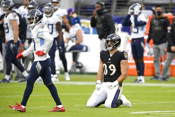 Baltimore Ravens tight end Mark Andrews (89) reacts after failing to catch a pass against Tennessee Titans cornerback Malcolm Butler, left, on a third down play during the second half of an NFL football game, Sunday, Nov. 22, 2020, in Baltimore. The Titans won 30-24 in overtime. (AP Photo/Nick Wass)
