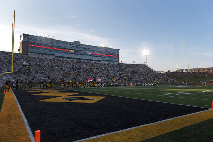 A socially distant crowd at Memorial Stadium watches Missouri take the field before the start of an NCAA college football game against Alabama, Saturday, Sept. 26, 2020, in Columbia, Mo. (AP Photo/L.G. Patterson)