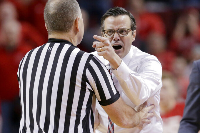 Nebraska coach Tim Miles argues a technical foul against him with official Terry Wymer, during the second half of an NCAA college basketball game against Maryland in Lincoln, Neb., Wednesday, Feb. 6, 2019. Maryland won 60-45. (AP Photo/Nati Harnik)