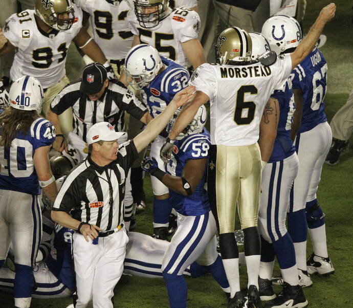FILE - In this Feb. 7, 2010, file photo, an official signals that the New Orleans Saints will have possession of the ball after an onside kick by Thomas Morstead (6) during the second half of the NFL Super Bowl XLIV football game against the Indianapolis Colts, in Miami. ean Payton risked everything to start the second half of Super Bowl 44. (AP Photo/Charlie Riedel, File)