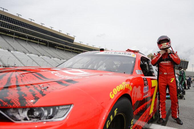 Justin Allgaier (7) puts on his helmet before a NASCAR Xfinity Series auto race at Atlanta Motor Speedway, Saturday, June 6, 2020, in Hampton, Ga. (AP Photo/Brynn Anderson)