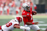 Ohio State quarterback Justin Fields, right, cuts upfield on his way to a touchdown against Miami (Ohio) defensive back Bart Baratti during the first half of an NCAA college football game Saturday, Sept. 21, 2019, in Columbus, Ohio. (AP Photo/Jay LaPrete)