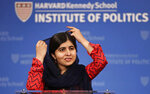 2014 Nobel Laureate Malala Yousafzai adjusts her scarf during an address at the Kennedy School's Institute of Politics at Harvard University in Cambridge, Mass., Thursday, Dec. 6, 2018. (AP Photo/Charles Krupa)