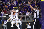 California's Jake Tonges (85) celebrates his touchdown reception with Gavin Reinwald against Washington in the first half of an NCAA college football game Saturday, Sept. 25, 2021, in Seattle. (AP Photo/Elaine Thompson)