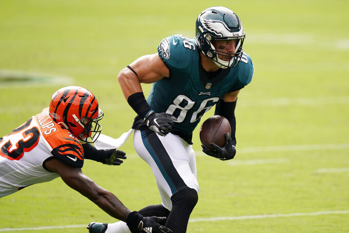 Philadelphia Eagles' Zach Ertz (86) runs past Cincinnati Bengals' Darius Phillips (23) during the first half of an NFL football game, Sunday, Sept. 27, 2020, in Philadelphia. (AP Photo/Chris Szagola)