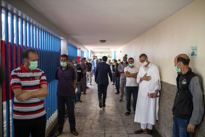 Inmates wait for their turn receive the AstraZeneca COVID-19 vaccine, in the Arjat prison on the outskirts of Rabat, Morocco, Wednesday, May 26, 2021. About 300 inmates in a prison near the Moroccan capital have been vaccinated against COVID-19, among the latest prisoners to  benefit from a vaccination campaign authorities say is a pioneering bid to protect a population considered especially vulnerable. (AP Photo/Mosa'ab Elshamy)