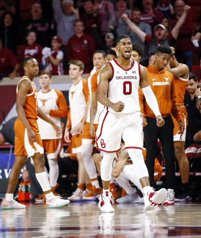 Oklahoma's Christian James (0) reacts at the end of an NCAA college basketball game against Texas in Norman, Okla., Saturday, Feb. 23, 2019. Oklahoma won 69-67. (Nate Billings/The Oklahoman via AP)