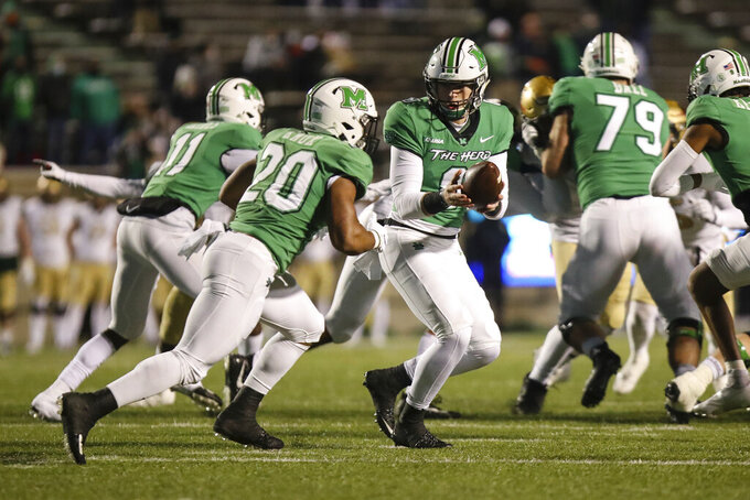 Marshall quarterback Grant Wells (8) hands off to teammate Brenden Knox (20)  during an NCAA college football game for the Conference USA Football Championship on Friday, Dec. 18, 2020,  in Huntington, W.Va.  (Sholten Singer/The Herald-Dispatch via AP)