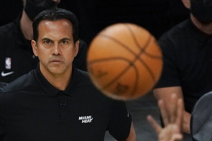 Miami Heat head coach Erik Spoelstra watches a shot during the first half of Game 1 of their NBA basketball first-round playoff series against the Milwaukee Bucks Saturday, May 22, 2021, in Milwaukee. (AP Photo/Morry Gash)