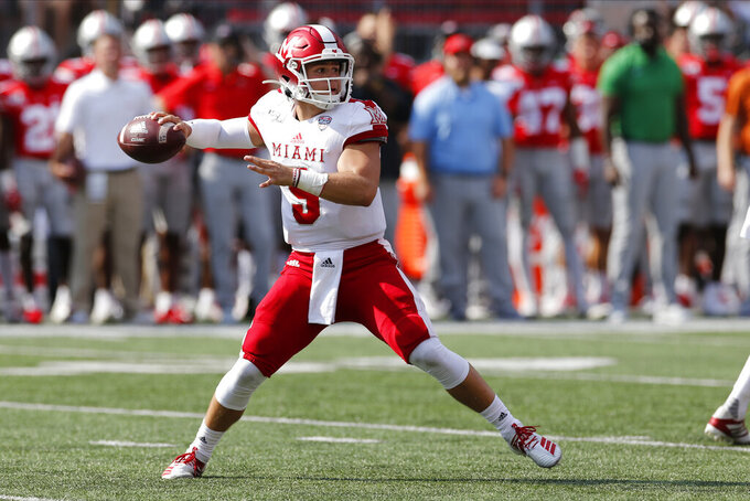 Miami (Ohio) quarterback Brett Gabbert drops back to pass against Ohio State during the first half of an NCAA college football game Saturday, Sept. 21, 2019, in Columbus, Ohio. (AP Photo/Jay LaPrete)