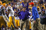 LSU head coach Ed Orgeron reacts on the bench on the sideline during the second half of the team's NCAA college football game against Florida in Baton Rouge, La., Saturday, Oct. 12, 2019. LSU won 42-28. (AP Photo/Gerald Herbert)