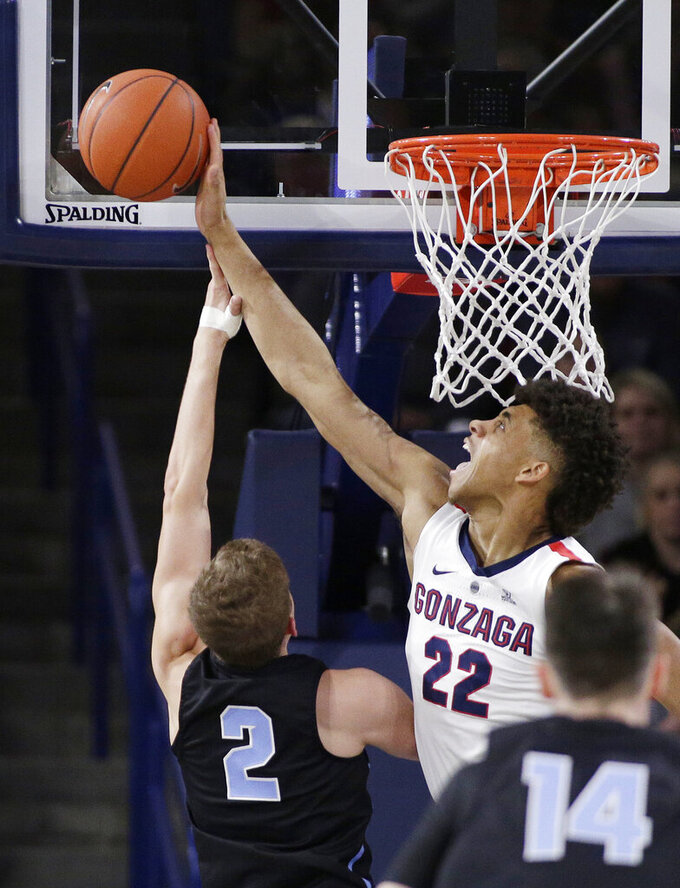 Gonzaga forward Jeremy Jones (22) blocks a shot by San Diego guard Joey Calcaterra (2) during the first half of an NCAA college basketball game in Spokane, Wash., Saturday, Feb. 2, 2019. (AP Photo/Young Kwak)