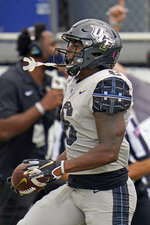 Central Florida wide receiver Marlon Williams celebrates his 54-yard touchdown on a pass play against Tulane during the first half of an NCAA college football game, Saturday, Oct. 24, 2020, in Orlando, Fla. (AP Photo/John Raoux)