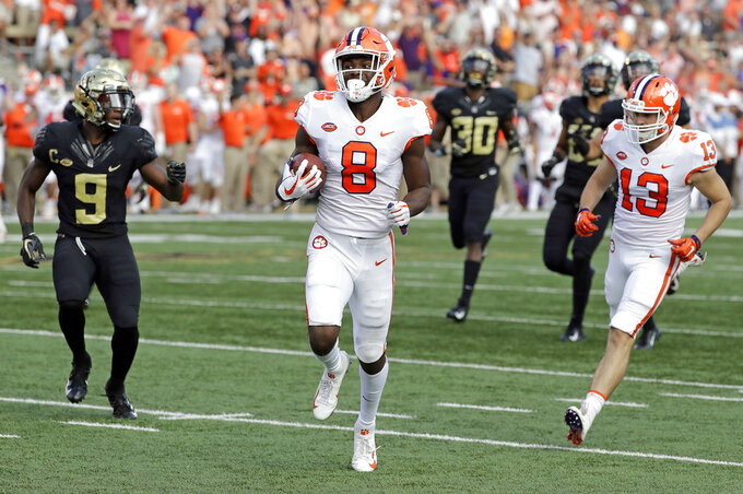 Clemson's Justyn Ross (8) runs past Wake Forest's Chuck Wade Jr. (9) for a touchdown during the first half of an NCAA college football game in Charlotte, N.C., Saturday, Oct. 6, 2018. (AP Photo/Chuck Burton)
