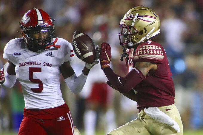 Jacksonville State cornerback Yessman Green (5) knocks away a pass intended for Florida State wide receiver Andrew Parchment, right, in the first quarter of an NCAA college football game Saturday, Sept. 11, 2021, in Tallahassee, Fla. (AP Photo/Phil Sears)
