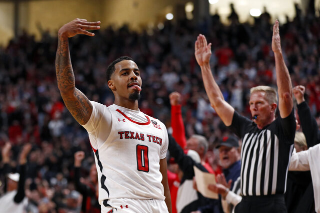 Texas Tech's Kyler Edwards (0) celebrates after scoring three points during the second half of an NCAA college basketball game against Iowa State, Saturday, Jan. 18, 2020, in Lubbock, Texas. (AP Photo/Brad Tollefson)