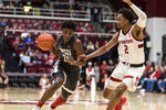 Washington State guard Noah Williams, left, drives to the basket as Stanford guard Bryce Wills (2) defends during the second half of an NCAA college basketball game Saturday, Jan. 11, 2020, in Stanford, Calif. (AP Photo/John Hefti)