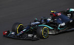 Mercedes driver Valtteri Bottas of Finland steers his car during qualification for the Formula One Portuguese Grand Prix at the Algarve International Circuit in Portimao, Portugal, Saturday, Oct. 24, 2020. The Formula One Portuguese Grand Prix will take place on Sunday. (Jorge Guerrero, Pool via AP)