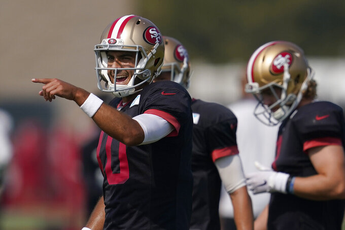 San Francisco 49ers quarterback Jimmy Garoppolo (10) gestures during NFL football practice in Santa Clara, Calif., Saturday, Aug. 22, 2020. (AP Photo/Jeff Chiu, Pool)