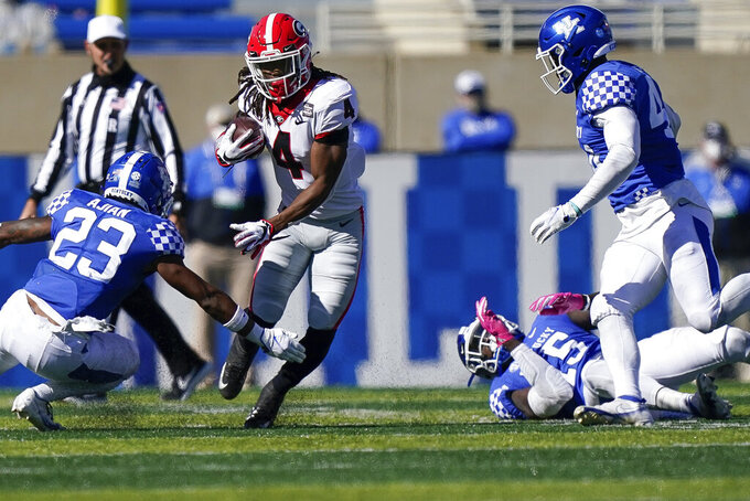 Georgia running back James Cook (4) runs with the ball during the second half of an NCAA college football game against Kentucky, Oct. 31, 2020, in Lexington, Ky. (AP Photo/Bryan Woolston)