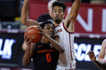 Oregon State guard Gianni Hunt (0) shoots against Southern California forward Isaiah Mobley, right, during the first half of an NCAA college basketball game Thursday, Jan. 28, 2021, in Los Angeles. (AP Photo/Ashley Landis)