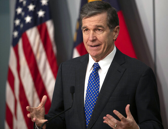 North Carolina Governor Roy Cooper speaks a press briefing on the COVID-19 virus, vaccination efforts, winter storms and schools reopening on Thursday, February 18, 2021 at the Emergency Operations Center in Raleigh, N.C.(Robert Willett/The News & Observer via AP)