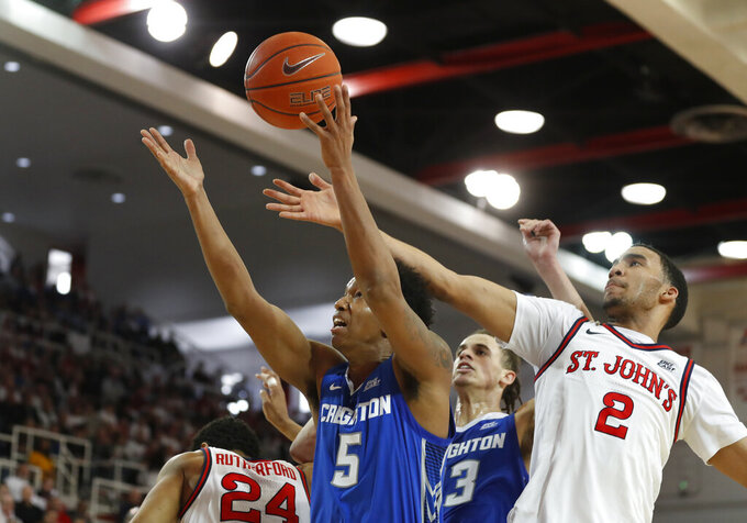 Creighton guard Ty-Shon Alexander (5) fights for control of the ball as St. John's guard Julian Champagnie (2) challenges him during the first half of an NCAA college basketball game, Sunday, March 1, 2020, in New York. (AP Photo/Kathy Willens)