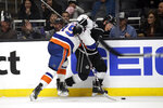Los Angeles Kings' Blake Lizotte, right, is pushed against the boards by New York Islanders' Cal Clutterbuck during the second period of an NHL hockey game Wednesday, Nov. 27, 2019, in Los Angeles. (AP Photo/Marcio Jose Sanchez)