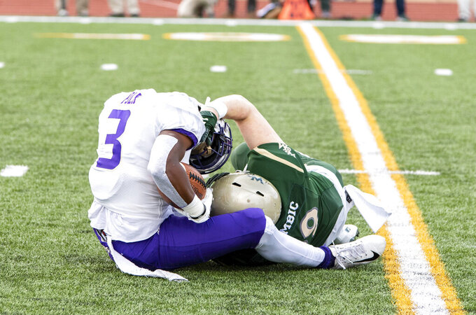 William & Mary's Trey Zgombic, right, brings down James Madison's Brandon Polk (3) on a kickoff return during the first half of an NCAA college football game in Williamsburg, Va., on Saturday, Oct. 19, 2019. (Mike Caudill/The Virginian-Pilot via AP)