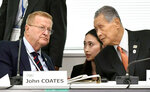 Top IOC official John Coates, left, talks with Yoshiro Mori, right, president of the 2020 Tokyo Olympics organizing committee, during a meeting to assess progress on the games of Tokyo 2020 Olympics, in Tokyo Wednesday, Oct. 30, 2019.  In the meeting, Tokyo Governor Yuriko Koike has told powerful IOC members she wants the Olympic marathon held in Tokyo and lashed out at what she called an