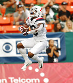 Arizona wide receiver Jamarye Joiner celebrates his second-quarter touchdown against Hawaii during an NCAA college football game Saturday, Aug. 24, 2019, in Honolulu. (AP Photo/Marco Garcia)