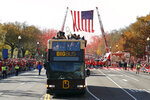 Fans cheer as a bus carrying the Washington Nationals' World Series trophy drives by during a parade to celebrate the team's World Series baseball championship over the Houston Astros, Saturday, Nov. 2, 2019, in Washington. (AP Photo/Patrick Semansky)