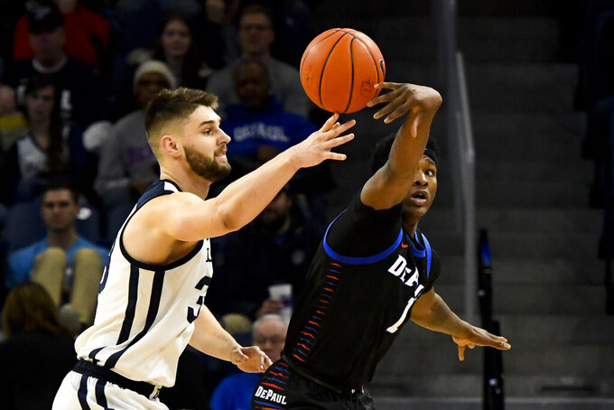 DePaul forward Romeo Weems (1) tips the ball away rom Butler forward Bryce Golden (33) during the first half of an NCAA college basketball game Saturday, Jan. 18, 2020, in Chicago. (AP Photo/Matt Marton)