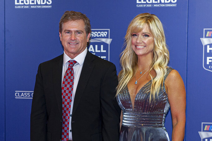 NASCAR Hall of Fame inductee Bobby Labonte along with his wife, Kristin, poses for pictures prior to the induction ceremony in Charlotte, N.C., Friday, Jan. 31, 2020. (AP Photo/Mike McCarn)