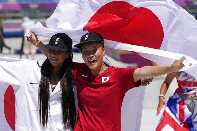 Gold medal winner Sakura Yosozumi, right, and silver medalist Kokona Hiraki, both of Japan, celebrate after the women's park skateboarding finals at the 2020 Summer Olympics, Wednesday, Aug. 4, 2021, in Tokyo, Japan. (AP Photo/Ben Curtis)