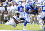 Duke's Quentin Harris (18) carries the ball past Georgia Tech's Bruce Jordan-Swilling (12) during an NCAA college football game in Durham, N.C., Saturday, Oct. 12, 2019. (AP Photo/Ben McKeown)