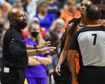 Los Angeles Sparks coach Derek Fisher argues with official Billy Smith (7) during the team's WNBA basketball game against the Connecticut Sun on Thursday, Aug. 26, 2021, in Uncasville, Conn. (Sean D. Elliot/The Day via AP)