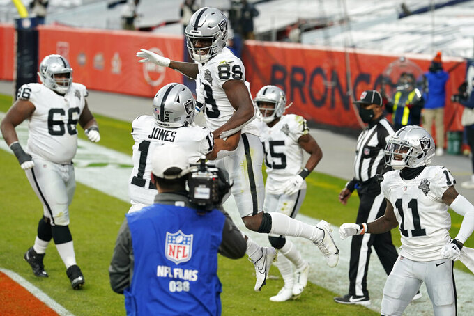 Las Vegas Raiders wide receiver Bryan Edwards (89) celebrates after scoring a touchdown against the Denver Broncos during the first half of an NFL football game, Sunday, Jan. 3, 2021, in Denver. (AP Photo/David Zalubowski)