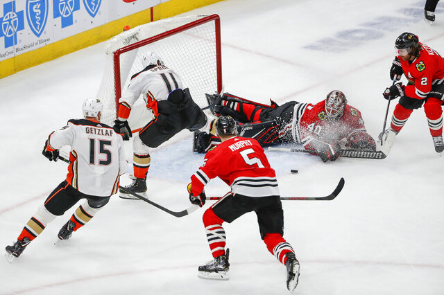 Chicago Blackhawks goaltender Robin Lehner (40) defends against Anaheim Ducks right wing Daniel Sprong (11) during the second period of an NHL hockey game Saturday, Jan. 11, 2020, in Chicago. (AP Photo/Kamil Krzaczynski)