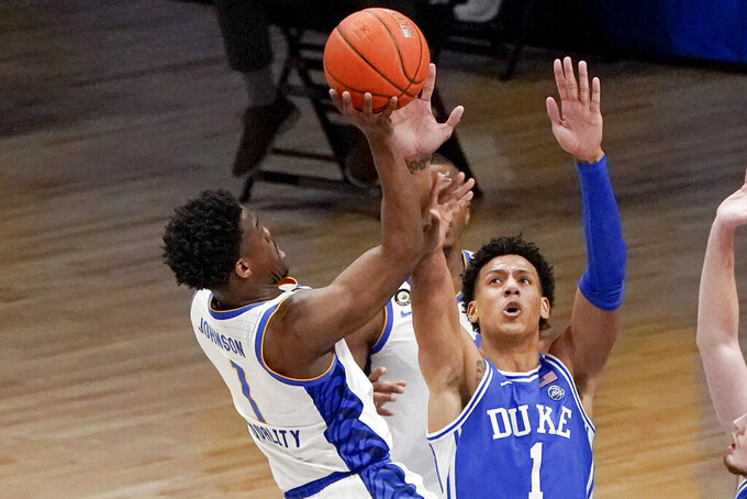 Pittsburgh's Xavier Johnson, left, shoots over Duke's Jalen Johnson during the second half of an NCAA college basketball game Tuesday, Jan. 19, 2021, in Pittsburgh. (AP Photo/Keith Srakocic)
