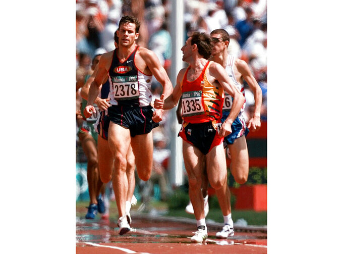 FILE - In this July 29, 1996, file photo, United States' Paul McMullen (2378), left, is seen during their 1,500 meter heat at the Summer Olympics in Atlanta. McMullen, died in a ski accident in northern Michigan, Eastern Michigan University said Friday, March 5, 2021. He was 49. (AP Photo/Doug Mills, File)