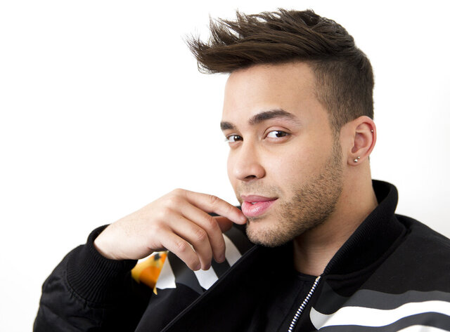 FILE - This Feb. 27, 2017 photo, singer Prince Royce poses for a photo in New York. Royce says he got a wake-up call with a COVID-19 diagnosis and now wants to try and wake others too. The Latin star told The Associated Press on Thursday that he is recovering from the virus. He says he decided to speak up out of a growing frustration with seeing people going out and gathering without protection. (Photo by Brian Ach/Invision/AP, File)
